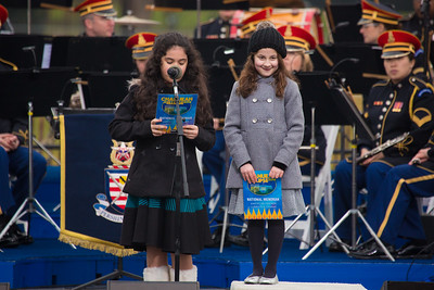 Simmy Hershkop, 11, of Wooster, Ma., (left) and Basya Fogelman, 9, of Wilkes Barre, Pa, (right) read their winning essays on what Hanukkah means to them as they participate in the annual National Menorah Lighting during a ceremony marking the start of the celebration of Hanukkah, on the Ellipse near the White House in Washington, Tuesday, Dec. 16, 2014.