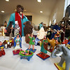 Barbara Eubanks of Ayer visits annual display at St. Andrew's Episcopal Church in Ayer of parishioner Carolyn Smith's collection of Nativity creches. (SUN/Julia Malakie)