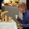 Penny Kelley of Ayer looks at a Nativity scene from the Slovak Republic. Annual display at St. Andrew's Episcopal Church in Ayer of parishioner Carolyn Smith's collection of Nativity creches. (SUN/Julia Malakie)