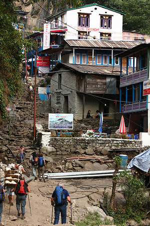 There are lots of villages with guest houses available to spend the night. Porters carry food from the valley to villages in the lower part of the trek. One of them is visible in the lower right part of the pictures.