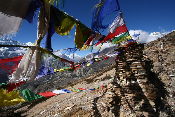 Prayer flags. The wind blows them and spreads the prayers and mantras written on each flag.