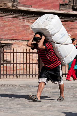 Porters always use a head band to carry their load.
