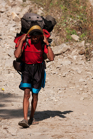 Many porters climb to high altitudes in slippers.