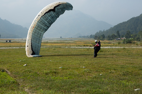 Pokhara is also famous for paragliding and we had the chance to see someone touching the ground next to us.