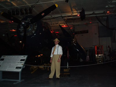 Yours truly standing in front of a TBM-3 Avenger Torpedo Bomber. I am dressed in my kickin' 40's outfit my fiancee whipped together for me.
