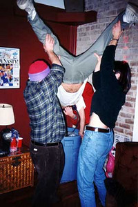 The Keg-stand - December 31, 1997<br /> Ricky's Apartment, Mobile, AL<br /> I was surprised how many people haven't heard of this little trick, so I felt obliged to include it here. It's just a little physics experiment. Great to get any party going, learned on the beaches of South Padre Island at Spring Break. A timeless classic.<br /> If you can't quite make out who's doing the actual keg-stand, the shoes may be your best clue (K-Swiss Classics.)