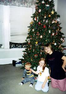 Wyatt, Elainee and Nicole by the christmas tree