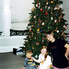 Wyatt, Elainee and Nicole by the christmas tree