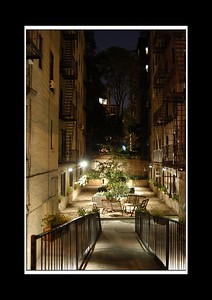 This is  lovely stolen photo of a gated and locked community garden at night... it looked the perfect place to share a coffee or beer with the neighbours,  It always pays to have an nose around the rich and wealthy sometimes...