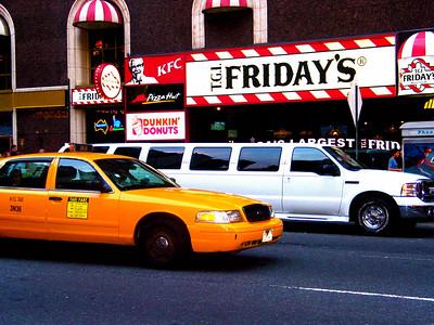 Yellow cab and limo, New York