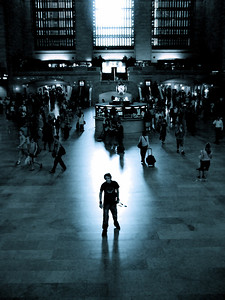 John Donkin in a beam of light at Grand Central Station, New York