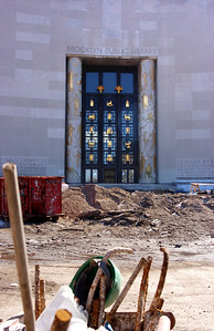 Start of the Brooklyn Tour from Terri  Welcome to the Brooklyn Public Library, or the front facade of it, being as they are re-paving and renovating the whole area around it.  I took this photo because I liked the work gear in front of the ornate doors, I would have liked the hard hat to be on the right hand hook - however this wasn't anywhere near reaching distance from where we stood.