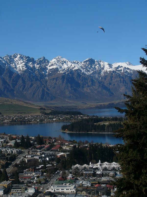 Queenstown is perhaps the premier tourist destination of New Zealand south island, if not New Zealand itself. There is plenty of 'adventure' tourism, such as bungee-jumping, horse-riding, white-water rides and various parachuting/para-gliding. The parachute in the picture is a tandem-jump from the same hill from which this picture was taken. This picture is taken from a cable-car servicing the hill.