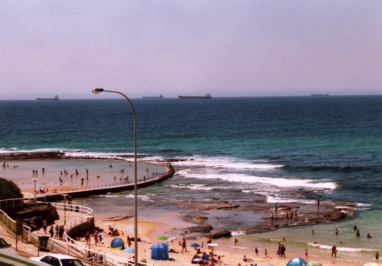 Canoe Pool, Shortland beach, Newcastle. Canoe Pool is a wading pool. Ocean Baths, a swimming pool, is just around the corner to the left. You can see some of those coal ships in the background, waiting to be filled up! Photo taken by Stephen Fong with Sigma SA-300N. January 2005.