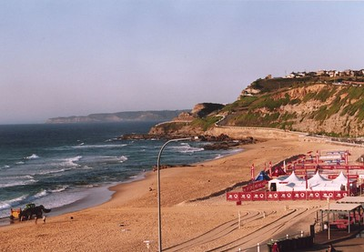 Shortland beach, Newcastle. Beach volleyball courts can be seen on the right hand side. Photo taken by Stephen Fong with Sigma SA-300N from a hotel room (Noah's). January 2005.