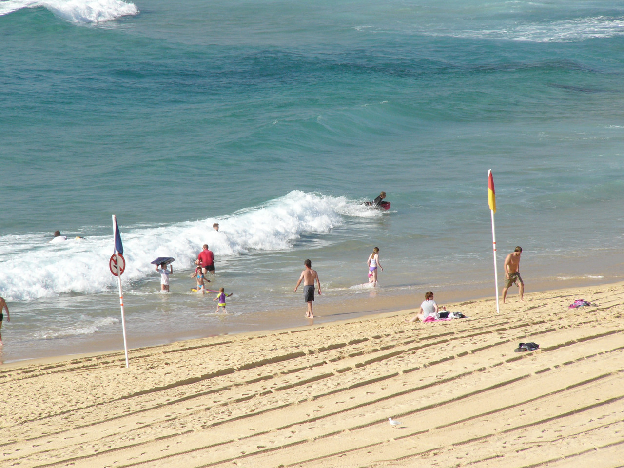 Shortland Beach, Newcastle. There are plenty of beaches around Newcastle to surf or swim, many of which are patrolled by lifesavers. Stay between the flags! 14 Jan 2005.