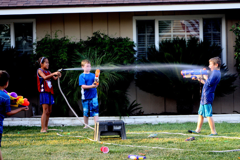 The hose wins the squirt gun fight.