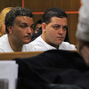 Listen in Fitchburg court to the hearing for Elsa Oliver and Alberto Sierraon Tuesday morning is Jeremiah Oliver's uncle Sandrino Oliver and his father Jose Oliver. SENTINEL & ENTERPRISE/JOHN LOVE
