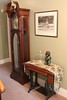 Long case clock and sewing machine in hall