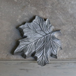 Maple leaf feature on wall outside reception