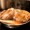 Cornbread-stuffed cornish game hen with corn maque choux