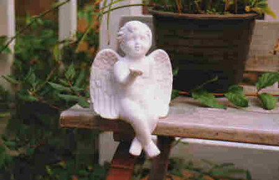 Angel on a bench - is it raining?, Flery Manor, Grants Pass, Oregon October 1999