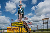 D183-2014  The giant statue of Uncle Sam that draws visitors to the Uncle Sam's Fireworks Store.  It stands on an elevated platform, I suppose to make it more visible from the highway.<br /> <br /> Located off U.S. 23 at the first exit north of the Ohio/Michigan border.<br /> Taken July 2, 2014