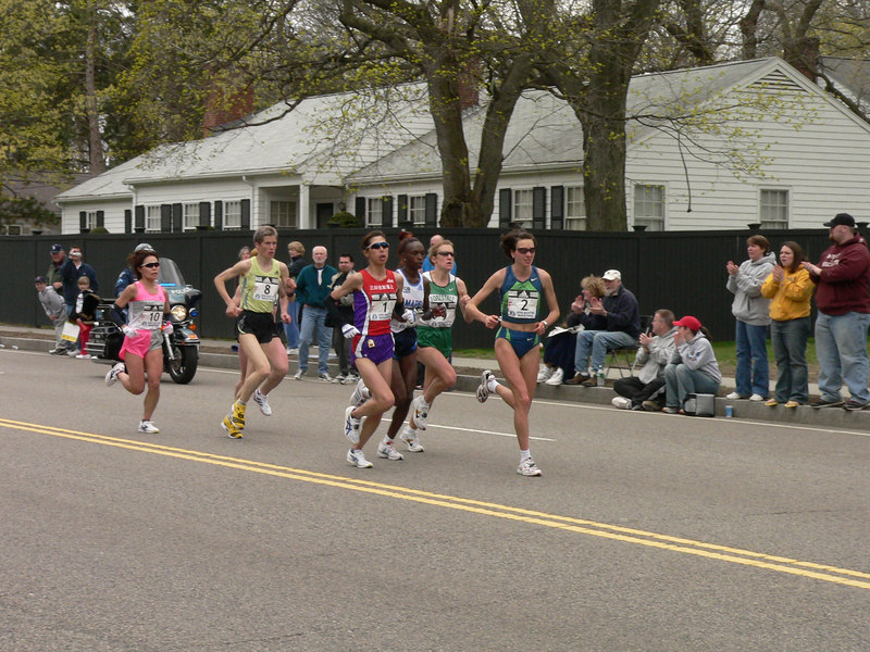 The lead group of women runners come through Newton, on Rte. 16 just before the course turns right onto Rte. 30, around the 17-mile mark.