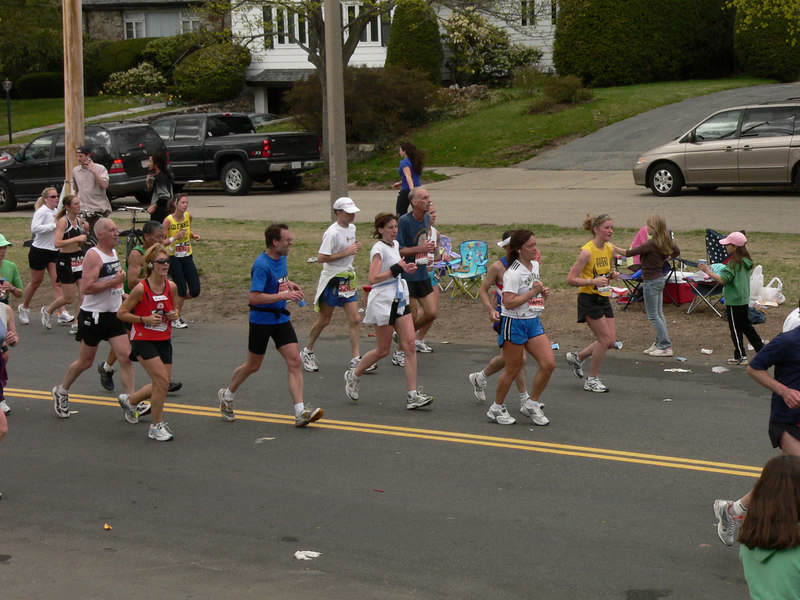 Runners heading up one of the Newton hills on Commonwealth Avenue