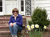 That's Marian in front of her house, with some of her beautiful daffodils