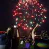 4th of July celebration at Pelham Elementary School. Jenn Tobin, left, and Karen Greenwood, both of Pelham, shoot the fireworks. (SUN/Julia Malakie)