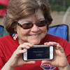 "4th of July celebration at Pelham Elementary School. Claudia Combs of Pelham guesses answers to the ""Disney deck"" of the game Head's Up. (SUN/Julia Malakie)"