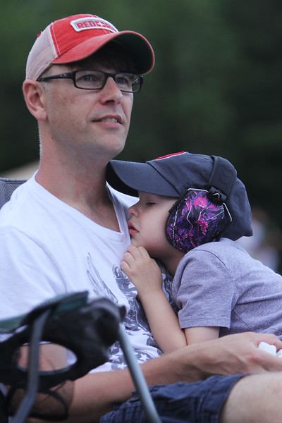 4th of July celebration at Pelham Elementary School. Rob Gordon of Pelham with son Caleb Gordon, 4, listening to Crossroads Church band. (SUN/Julia Malakie)