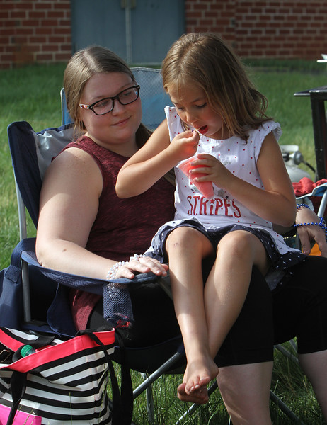 4th of July celebration at Pelham Elementary School. Heather Wormald, 20, of Pelham, with her boss's daughter Makenna Comtois, 6, also of Pelham, at the Free to Breathe booth. (SUN/Julia Malakie)