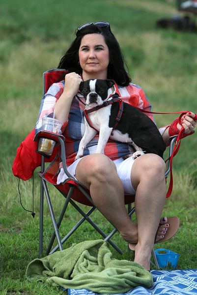 4th of July celebration at Pelham Elementary School. Joann Spain of Hudson, N.H., listens to band with her Boston terrier, Daisy May. (SUN/Julia Malakie)