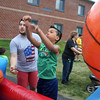 4th of July celebration at Pelham Elementary School. Cameron Cruz, 8, of Methuen, tries to make baskets at activity run by Todd Spain of Pelham, with Crossroads Church. (SUN/Julia Malakie)