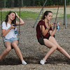 4th of July celebration at Pelham Elementary School. Olivia DeLoreto, 14, left, Casey Haverty, 13, both of Pelham, hang out on the swings. (SUN/Julia Malakie)