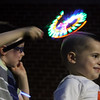4th of July celebration at Pelham Elementary School. Lincoln Camuso, 5, of Hudson, N.H., left, plays with a light toy that he already had before, but which seemed appropriate to bring for 4th of July. At right is his cousin Owen Lepine, 3, of Pelham. (SUN/Julia Malakie)