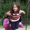 4th of July celebration at Pelham Elementary School. Lauren Green, 5, of Pelham, gets a push on the swings from her mother Becky Green. (SUN/Julia Malakie)