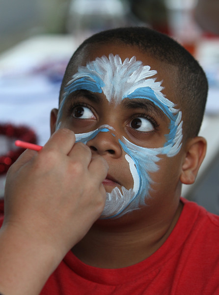 4th of July celebration at Pelham Elementary School. 8-year-old Gabriel Morel of Pelham has his face painted like a polar bear. (SUN/Julia Malakie)