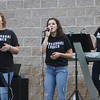 4th of July celebration at Pelham Elementary School. From left, Morgan Apkarian, her sister Cassandra Apkarian, and Allie Lyons, all of Pelham, perform with Crossroads Church band. (SUN/Julia Malakie)