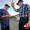 4th of July celebration at Pelham Elementary School. WWII veteran Fran Walsh of Pelham, N.H., left, and Vietnam veteran George Blankenship of Windham, N.H., chaplain with Post 10722, pass out poppies. (SUN/Julia Malakie)