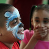 4th of July celebration at Pelham Elementary School. Sarah Morel, 5, of Pelham reacts to her 8-year-old brother Gabriel Morel's face being painted like a polar bear. (SUN/Julia Malakie)