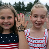 4th of July celebration at Pelham Elementary School. Best friends Alyssa Maille, 10, left, and Morgan Allard, 9, both of Pelham, with their hands they had decorated with henna. (SUN/Julia Malakie)