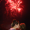 Samantha Bond of Dracut and her son Colton Hilbert, 23 months old, watch the fireworks at 4th of July celebration at Pelham Elementary School. (SUN/Julia Malakie)