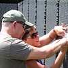 The Moving Wall replica of the Vietnam Veterans Memorial comes to Pelham Village Green for Memorial Day weekend. Jim and wife Vicki Gotay of Windham, N.H., do a rubbing of the name of James A. St. Cyr for a friend who was St. Cyr's wife when he was killed at age 19 shortly after they married. (SUN/Julia Malakie)