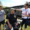 The Moving Wall replica of the Vietnam Veterans Memorial comes to Pelham Village Green for Memorial Day weekend. Matthew Moll, 13, of Manchester, N.H., and his grandparents Bob and Mary-Ellen Moll of Salem, N.H. (SUN/Julia Malakie)