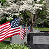 Flags on veterans' graves at Fairview Cemetery in Westford, ahead of Memorial Day weekend.  (SUN/Julia Malakie)