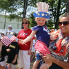 Annual Memorial Day parade at Building Blocks Preschool & Kindergarten. Preschool teacher Michelle Rosenquist of Lowell holds preschool student Quinn McCabe, 3, of Lowell, after the parade. (SUN/Julia Malakie)