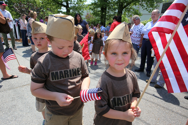 Annual Memorial Day parade at Building Blocks Preschool & Kindergarten. Blake Dellucci, 4, of Lowell, center, and Emily Landers, 4, of Andover, right. (SUN/Julia Malakie)